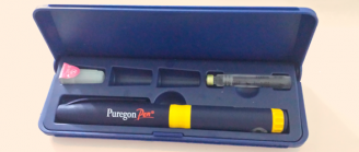 An open box displaying a Puregon Pen