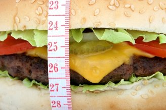 Close-up of a hamburger with a measuring tape around it